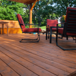 Staining Decks!- stained wood deck with furniture