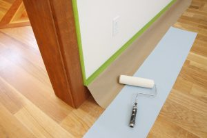 a professional painter preparing for detailed cut lines