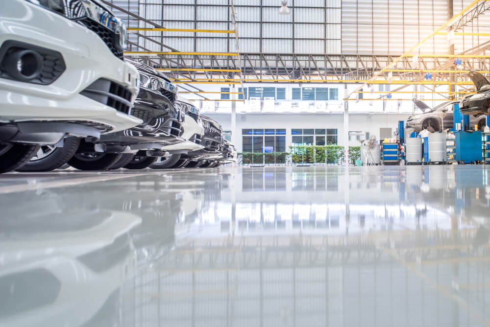 shiny epoxy floor in a car dealership