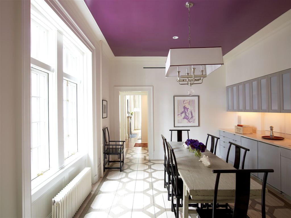 A magenta painted ceiling in the kitchen of a home.